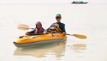 kayak dad and son telunas-beach-resort-activities_30741360327_o
