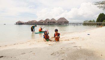 kids on sand on beach telunas-beach-resort-activities_31809589878_o