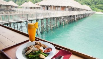 meal and orange drink telunas-beach-resort_43864349390_o
