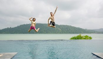 jump 2 adults infinity pool telunas-private-island-infinity-pool_28993936417_o