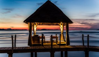 spa hut sunset telunas-private-island_44135330722_o
