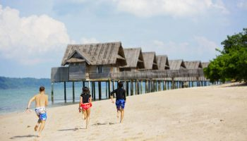 kids running on beach telunas-private-island_44959007194_o